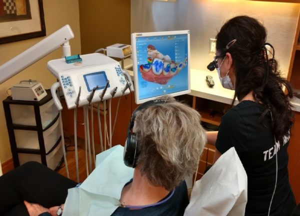 dentist designing CEREC ceramic crown