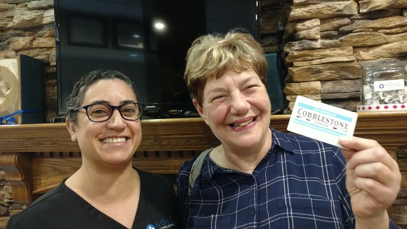 Hygienist presents cooking prize to draw winner