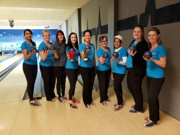 Dr. Provo & Team NOVO holding bowling balls ready to bowl