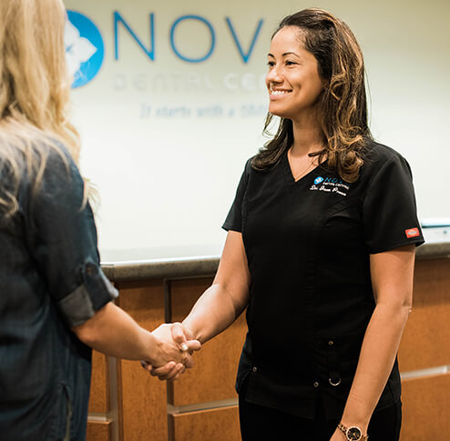 Dr Provo is greeting a client at NOVO Dental Centre Abbotsford
