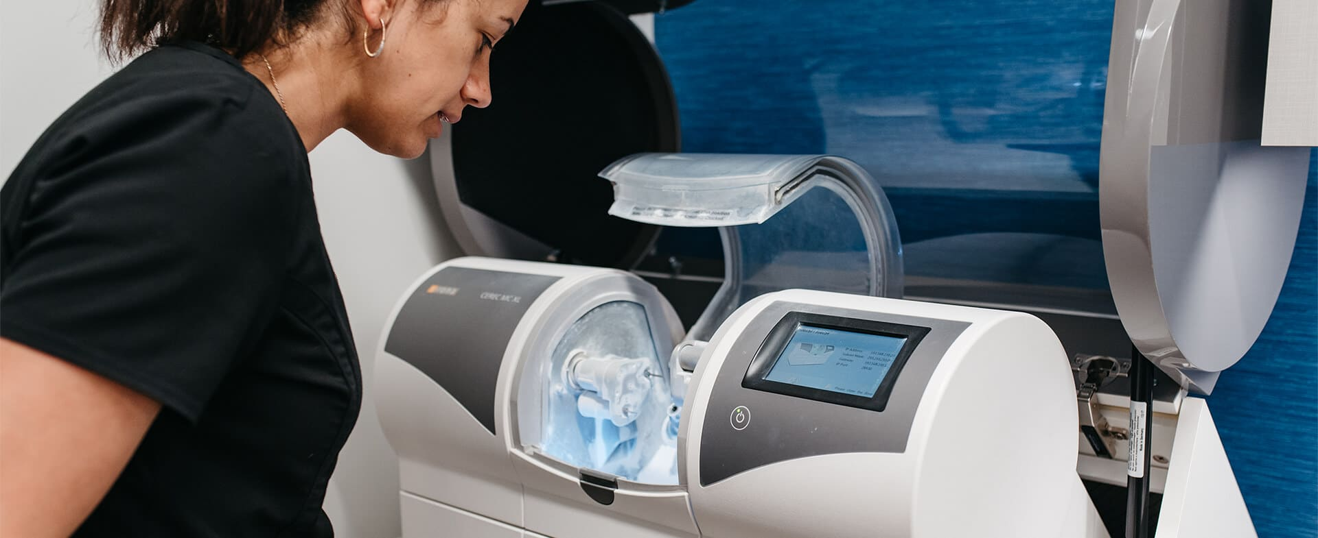 Dr. Provo inspects CEREC milling machine