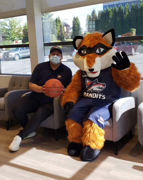 Berry The Bandit sitting in NOVO Dental Centre's reception area